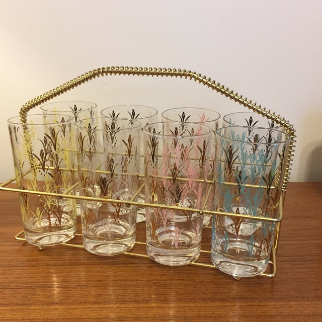 Great set of floral print Fred press glasses complete with brass drink Caddy. Glasses are in great shape with some wear on...