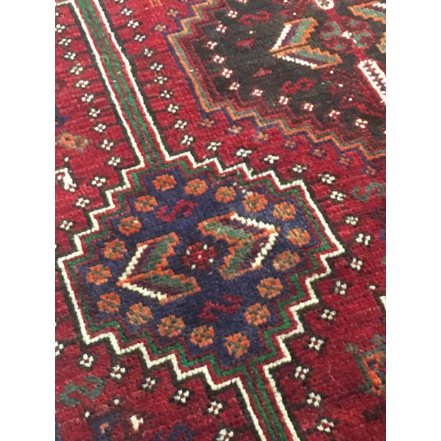 "Gorgeous hand made Persian Shiraz style rug. Measures 4'6"" X 8'6"""