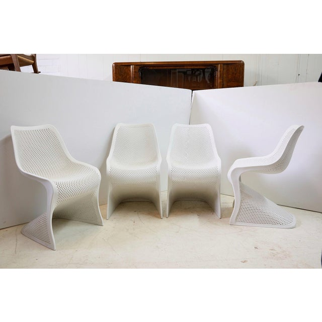 The Bloom chair by Compamia features a contemporary, canilevered design with commercial strength. The white chairs are...