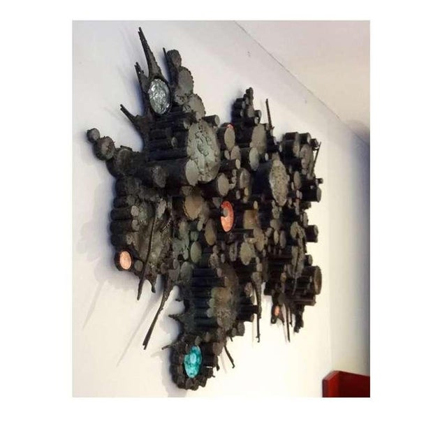 Large scaled Mid-Century wall sculpture featuring a body composed of dimensional circles and spikes in blackened steel...