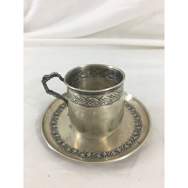 This charming espresso cup and saucer dates from the 1860's. It is in good condition with a little tarnish around the...