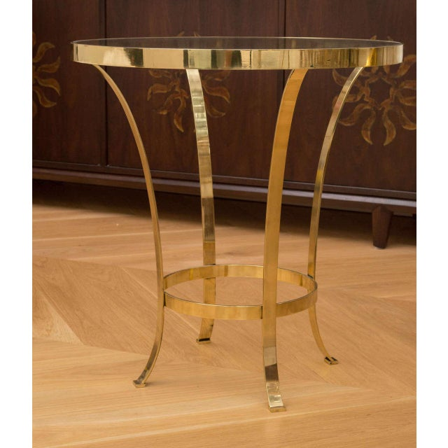 Beautiful brass and glass top occasional table.