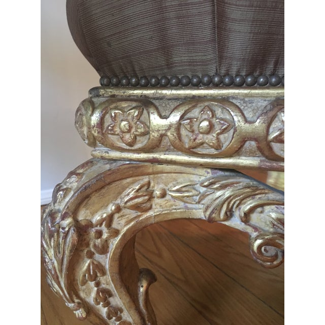 This is a lovely ornately carved ottoman in solid alder wood with genuine 22k gold leaf. It is a prefect accent to any...