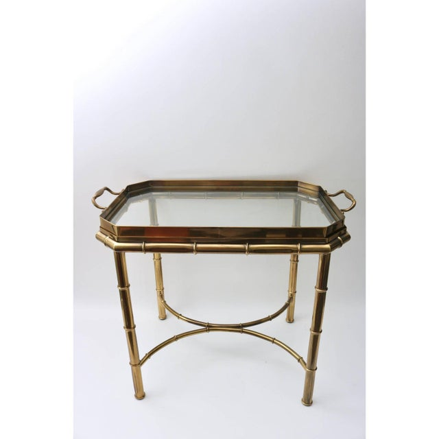 This stylish Master Craft furniture, Hollywood Regency faux bamboo table has a removable tray top that make serving an...
