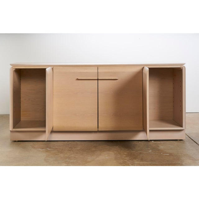 Very unusual light cerused oak cabinet by Ello. Great lines and ample storage space. Slight discoloration to top as shown....