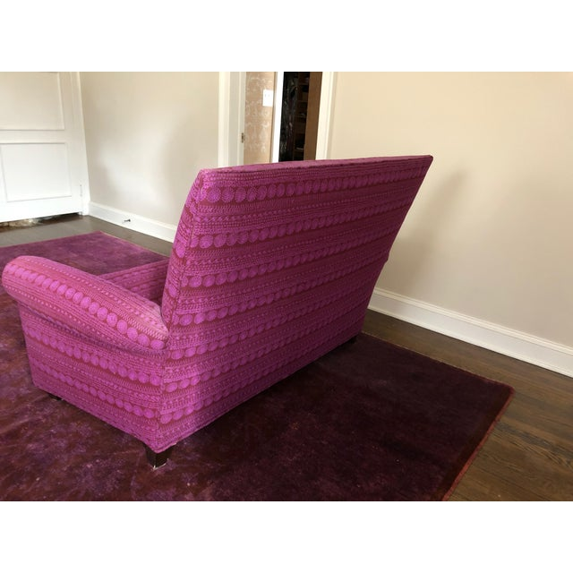 Highly styled Italian loveseat with high back, two seat cushions, and bold fuschia upholstery by Knoll.