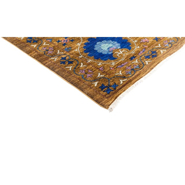 Inspired by embroidered Suzani textiles from Uzbekistan, this rug features floral motifs in modern palettes and...