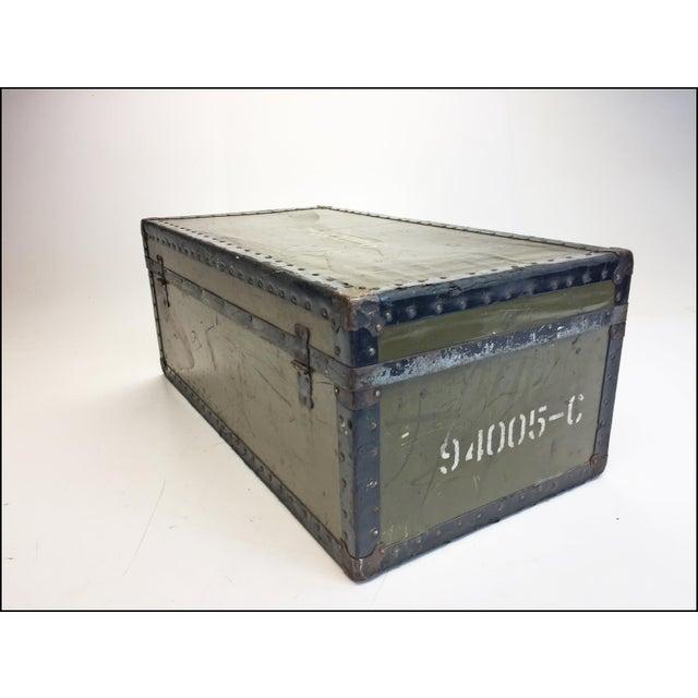 Vintage Military Foot Locker. Amazing storage locker. Hardshell wood with drab green vulcanized cover. Has metal...