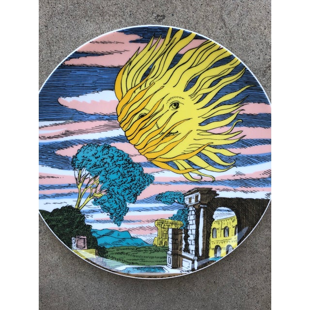 Piero Fornasetti for Rosenthal 12 Mesi 12 Soli (12 Months 12 Suns) plate. It features a colorful sun with the beams...