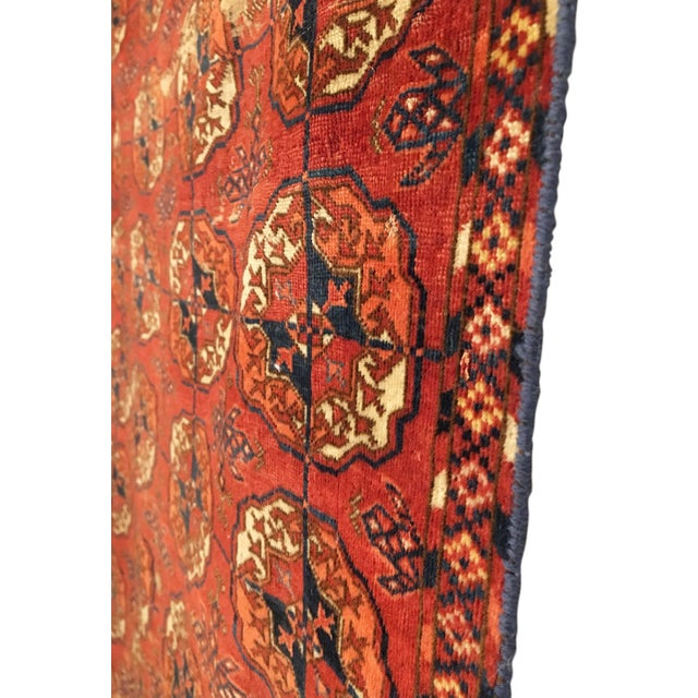 This early Tekke small main carpet rug was woven in the mid 19th Century by the Tekke Turkmen tribal groups in Central...