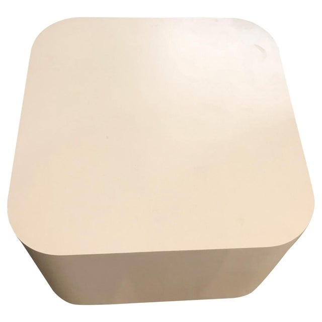 Bring modern glamour with these creamy off-white laminate and particle board side tables. Rounded corners and a brass-...