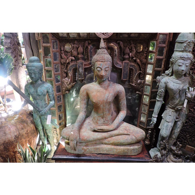 This fabulously oxidized and patina'd cast bronze Thai Buddha in the style of the Sukhothai period has gentle hands,...