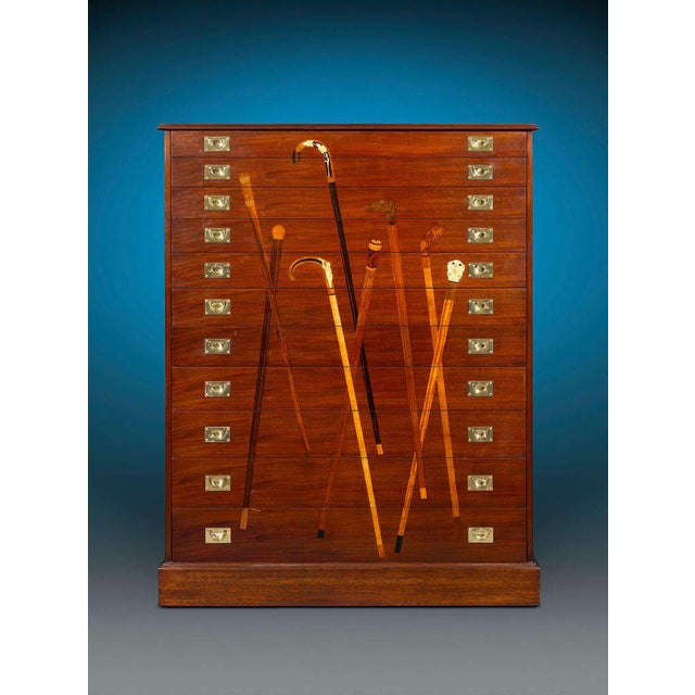 The function of this outstanding, custom-crafted mahogany cane cabinet is clear thanks to its beautifully inlaid...