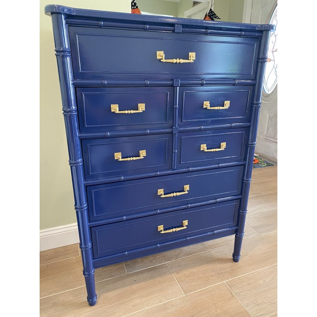 5 drawer tall faux bamboo chinosere dresser freshly lacqured in a gorgeous Sherman William naval navy blue. The hardware...