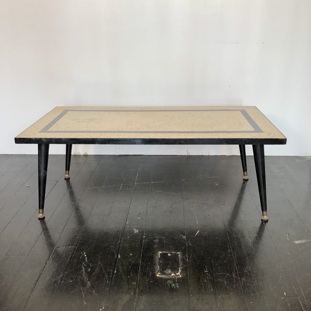 Lovely 1950s mid century modern terrazzo coffee table. Wonderful inlaid poured marble top with iron frame and tapered...
