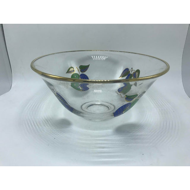 This is a lovely vintage Mid-century modern, Georges Briard gold rimmed glass bowl. It is adorned with blue & green fruit...