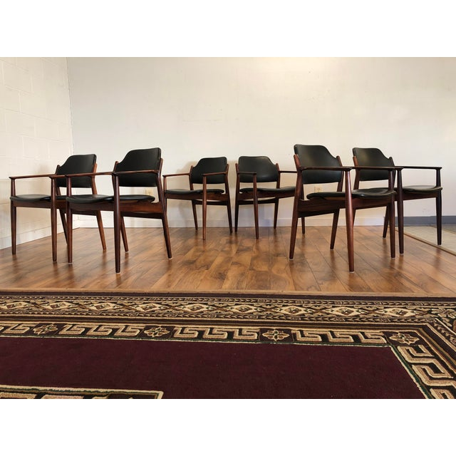Amazing set of six rosewood and leather dining chairs by Arne Vodder for Sibast, made in Denmark. These chairs are model...