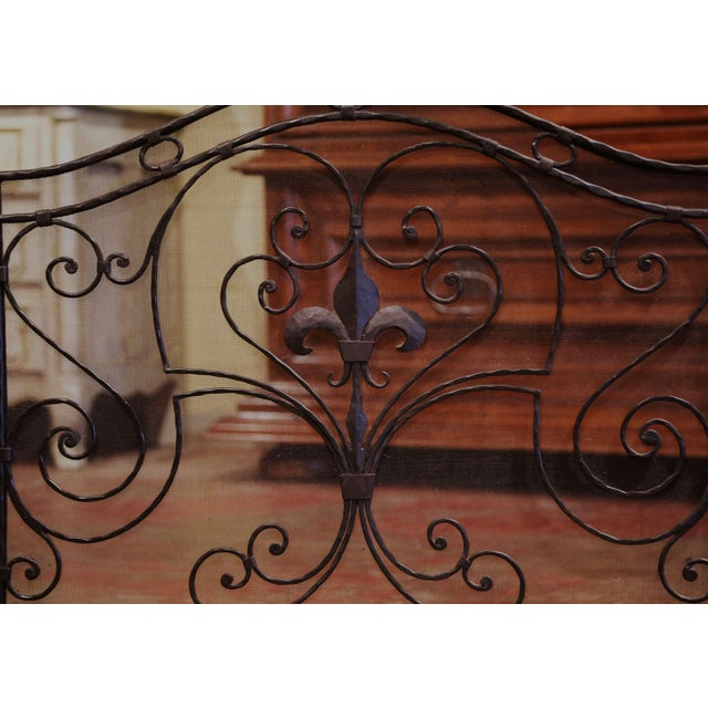 Decorate a fireplace hearth with this elegant iron screen. Created in France circa 1970 and standing on small scrolled...