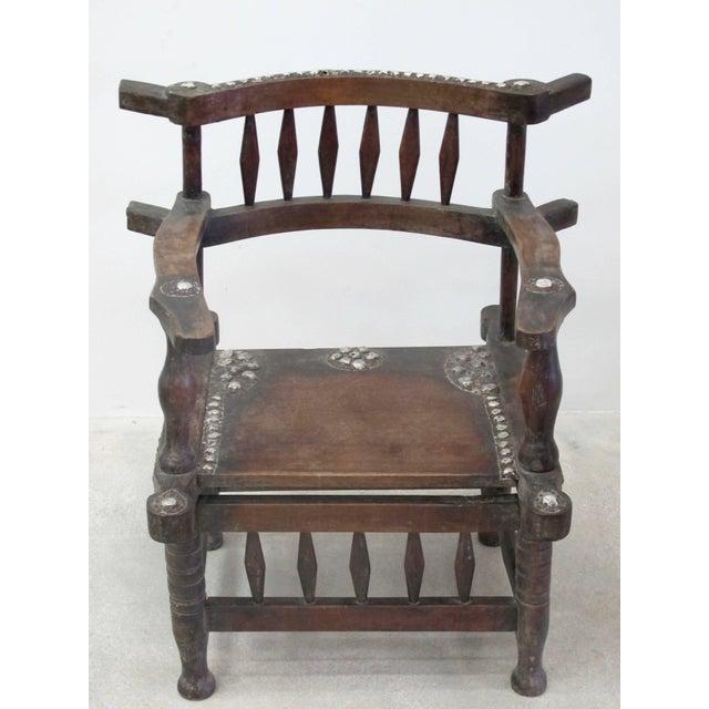 Rare 1950s Ashanti Throne Chair A rare 1950s Ashanti throne chair created in wood with metal decoration.