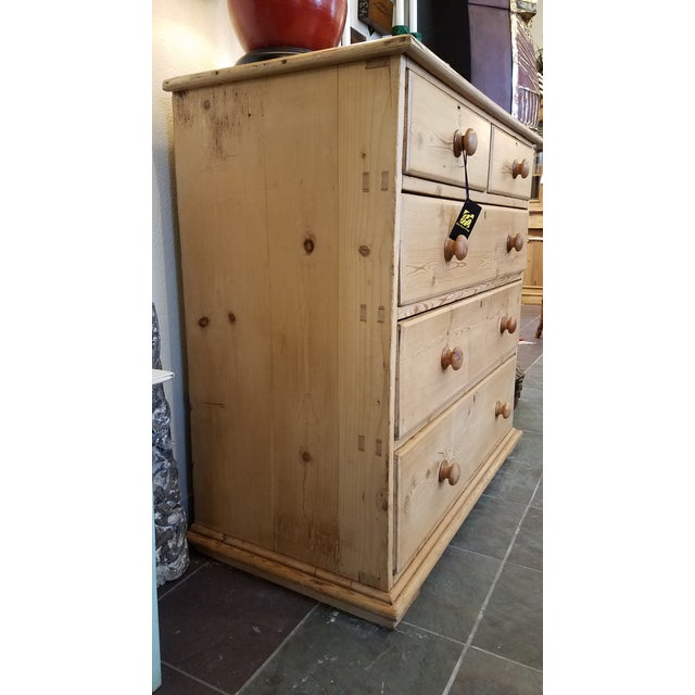 Add this beautiful pine chest of drawers to your room's decor. Featuring a rectangular top above two short drawers, and...