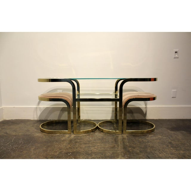 Really cute console table and chairs in brass chrome and glass. Has pair of brass stools in pink fabric that fit neatly...