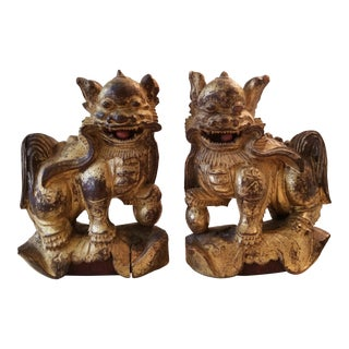 20th Century Chinese Hand-Carved Wooden Foo Dogs - a Pair For Sale