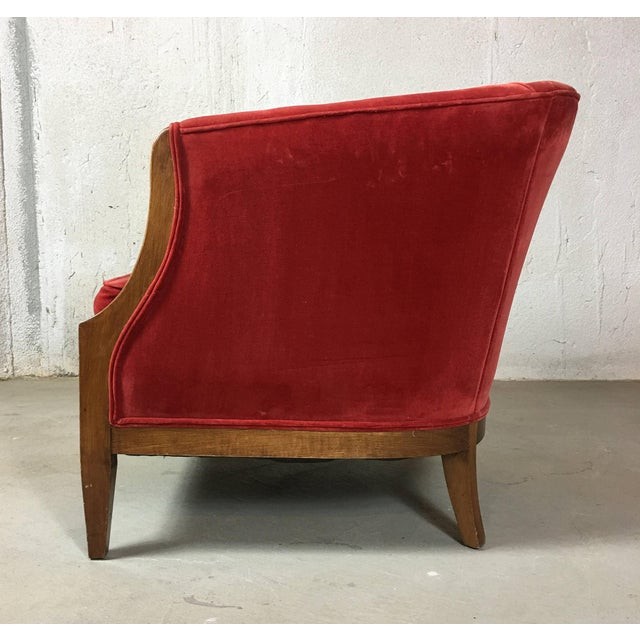 Elegant barrel or tub chair in cranberry red velvet. The piece is from the mid 20th century.