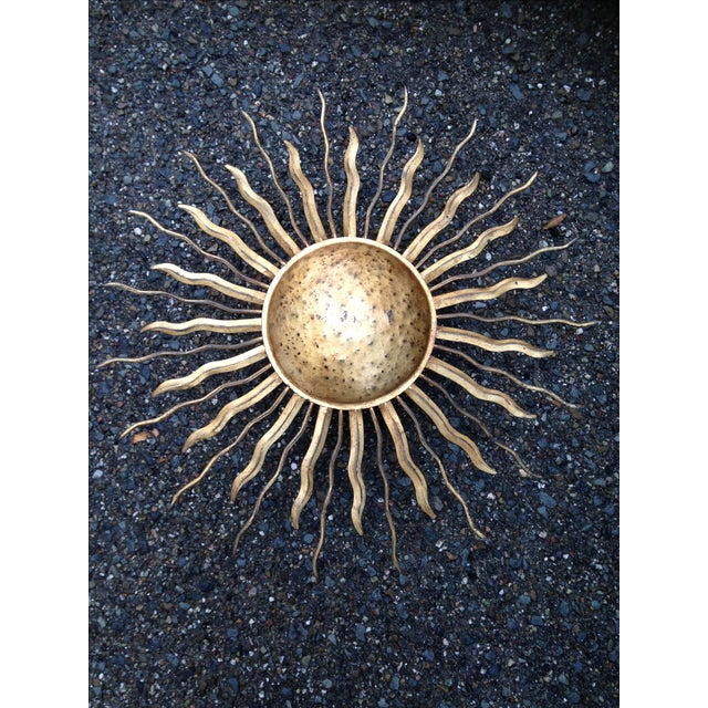 These three sun-shaped sconces are all exactly alike, and feature a rustic gold finish. 120V, 25W, 2 bulbs for each...
