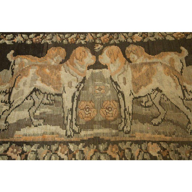 Unusual Kilim from the Caucasus with a brown ground and four large mastiffs surrounded with a flower border. Purchased at...