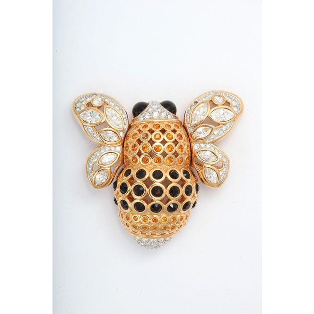 Huge, beautifully detailed goldtone bee brooch decorated with Swarovski crystals. Two small stone are missing. Due to the...