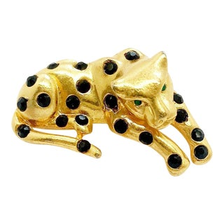 Gold Plated Leopard Brooch With Black Crystals Body and Green Crystal Eyes by Kenneth Jay Lane For Sale