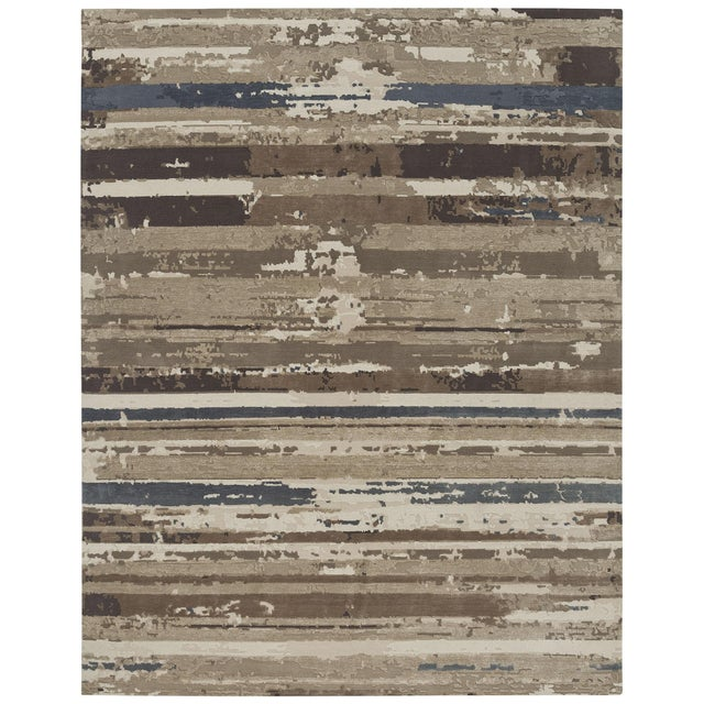 This hand knotted carpet is made of wool and silk pile. We stock standard sizes and accept custom size, shape and color...