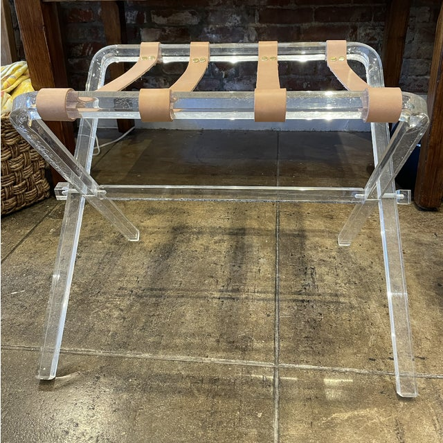 Modernist style folding luggage rack. Multipurpose accent table with a captivating mix of materials.