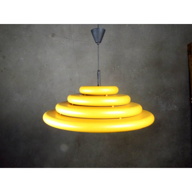 Fog & Morup Pendant chandelier of four concentric rings from the 1970s. In yellow, the most luminous of all the colors of...