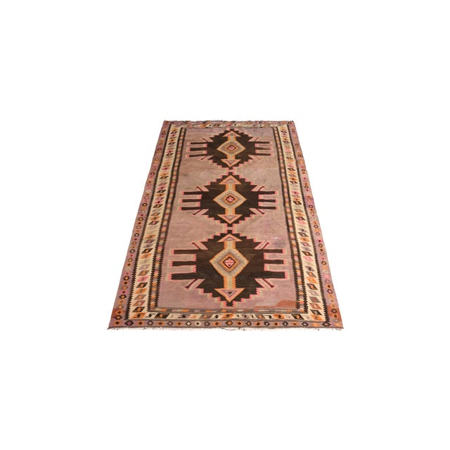 Handmade in flat woven wool circa 1950-1960, this vintage rug is a mid-century Persian Kilim enjoys both a rare color and...