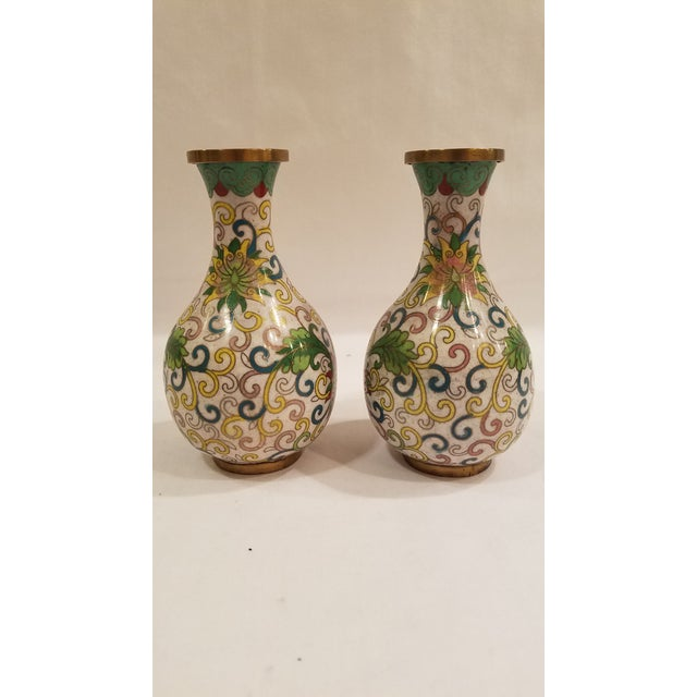 Here is a pair of beautiful Chinese cloisonne vases from 1900-1920. These vases are in excellent condition. Colors still...