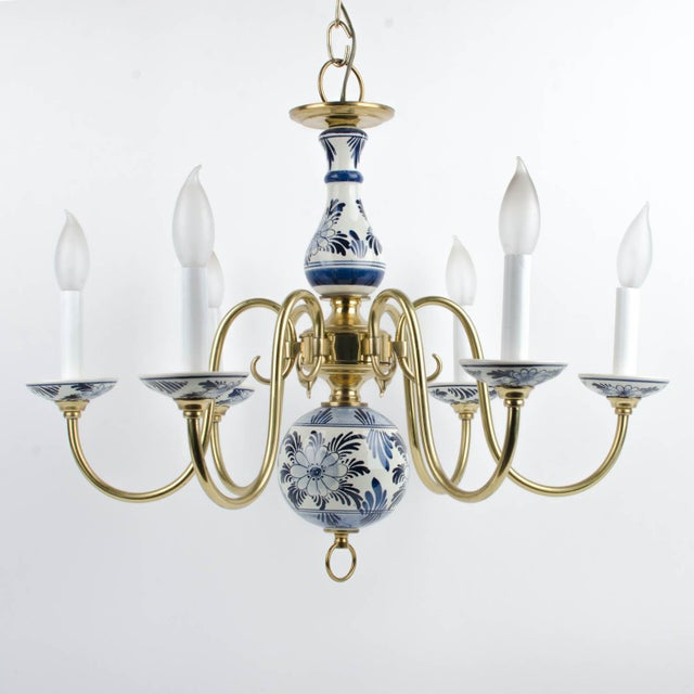 Vintage Delft hand painted blue & white ceramic six light chandelier with brass arms. In excellent condition. No ceiling...