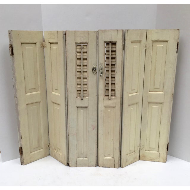 Imported from France. A set of two trifold shutters. The inside shutters are louvered. The middle and outside shutters...