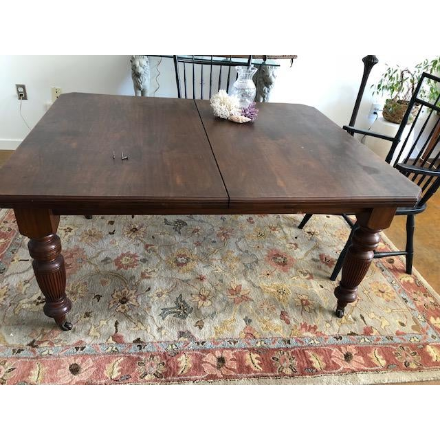 """A Victorian walnut dining table w/ two leaves. Crank opener which needs repair. Measurements: 46"""" wide 57"""" long 2 leaves @..."""