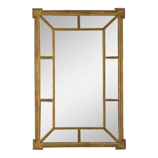 A handsome gold leaf frame in the manner designed by famed English architect Robert Adam that encloses the mirror glass from England c. 1895 For Sale