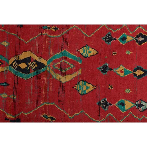 "Saturated Red tones make this rug a stunning beauty. Made in Morocco Measures: 10'6"" x 4'9"""