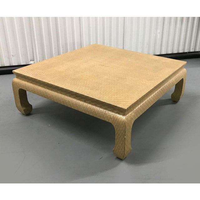 Generously sized, handsome coffee table by Baker, c.1980s. Styled after Karl Springer. Entire table is covered in woven...
