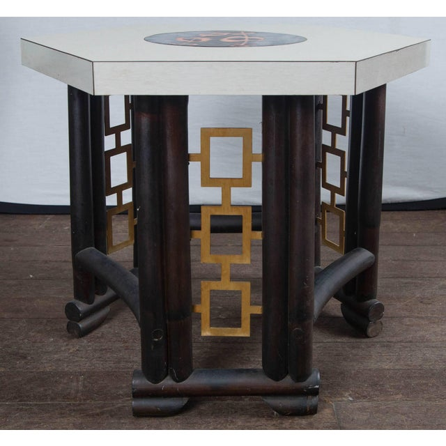 Custom-made Asian, bamboo style wood table, laminate top with inlaid round enameled piece in center. Geometric gilt metal...