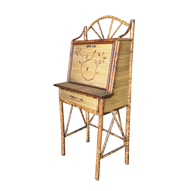 Tiger bamboo secretary desk with handwoven rice mat coverings and cut bamboo floral sculpture along the front, center...