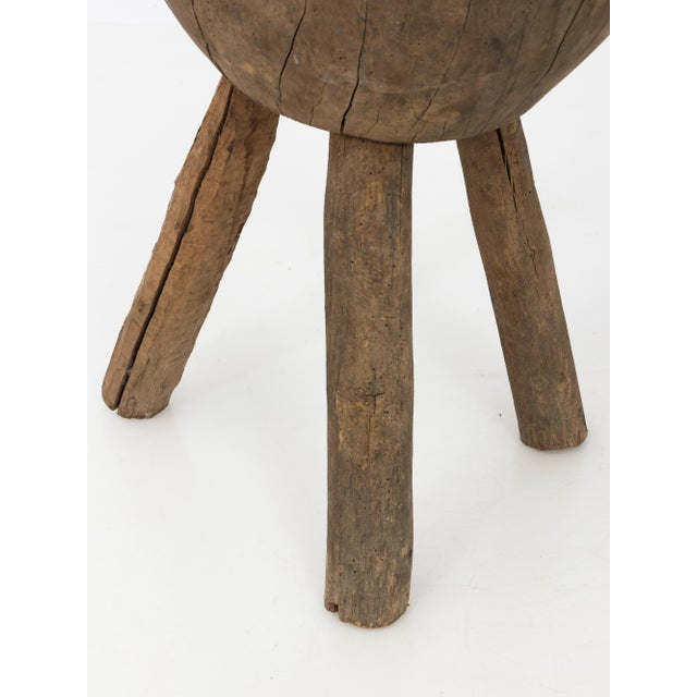A three-legged small French walnut butcher's block. Perfect for a side table. Beautiful wear and patina. One leg removes.