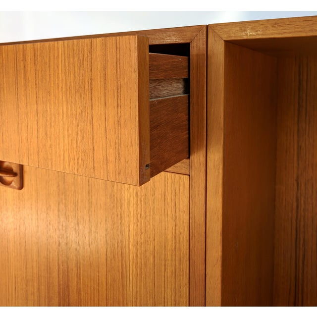 1960s Danish Modern teak small credenza or cabinet with metal hairpin legs. The credenza is in excellent condition, and...