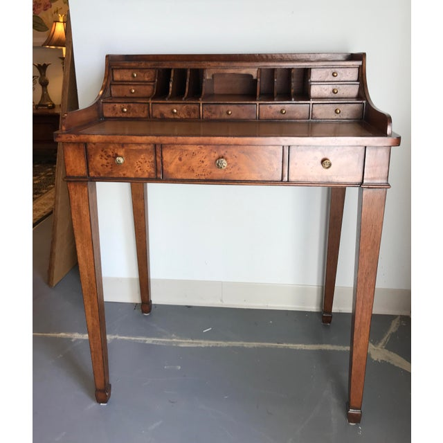 Perfectly sized writing desk for any space. Three main drawers on bottom, six smaller drawers up top. Leather inlaid...