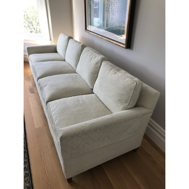 This sofa was purchased in 1965 and is solid wood with feather filled cushions. The upholstery is cream or white jacquard...