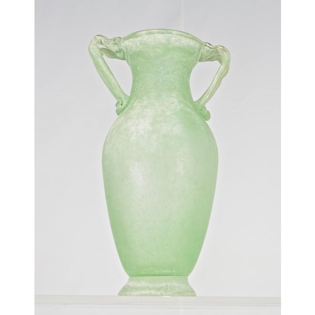 Wonderful pale green in elegant form with applied double handles. Handblown, Murano, Italy, circa 1970s.