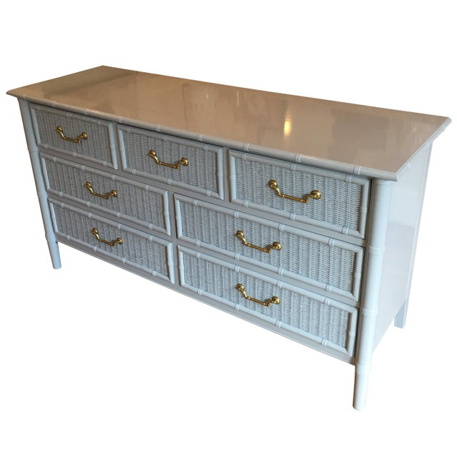 Available is a beautiful vintage Dixie faux bamboo and wicker 7 drawer dresser with original hardware lacquered Sherwin...